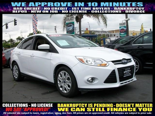 2012 FORD FOCUS SE 4DR SEDAN white welcome take a test drive or call us if you have any quest
