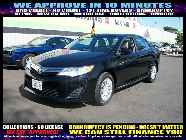 2012 TOYOTA CAMRY black welcome take a test drive or call us if you have any questions you wo