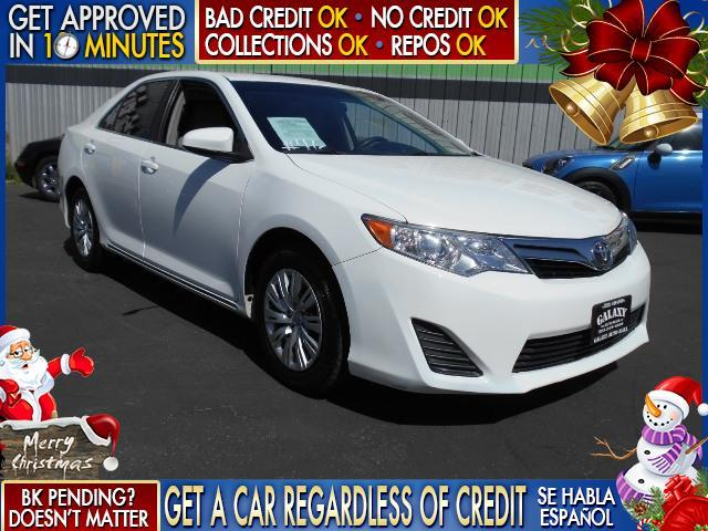 2013 TOYOTA CAMRY white  welcome take a test drive or call us if you have any questions you