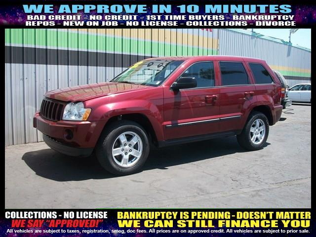 2007 JEEP GRAND CHEROKEE LAREDO 4DR SUV red welcome take a test drive or call us if you have an