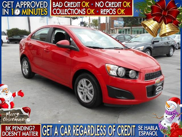 2013 CHEVROLET SONIC LT AUTO 4DR SEDAN W 1SD red  welcome take a test drive or call us if you