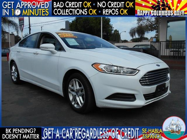 2013 FORD FUSION SE 4DR SEDAN white  welcome take a test drive or call us if you have any ques