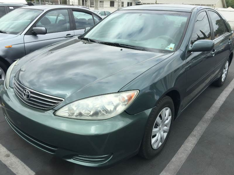 2005 TOYOTA CAMRY LE 4DR SEDAN military green cash price  plus applicable fees abs - 4-wheel cen