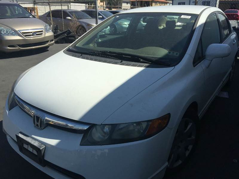 2006 HONDA CIVIC LX 4DR SEDAN WMANUAL white cash price plus aplicable fees abs - 4-wheel air fi