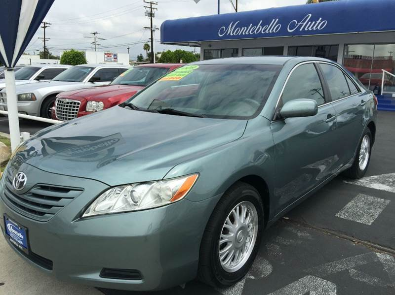 2009 TOYOTA CAMRY SE 4DR SEDAN 5A green cash price  plus aplicable  fees 2-stage unlocking - remo