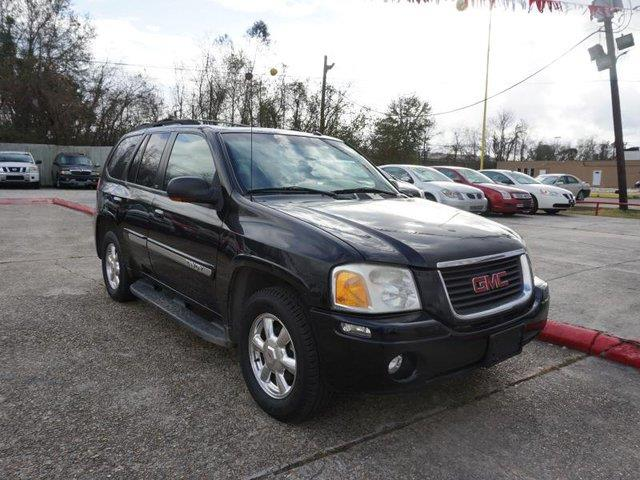 2004 GMC ENVOY 2WD SLE black driver adjustable lumbarfront reading lampsvehicle anti-theft syst