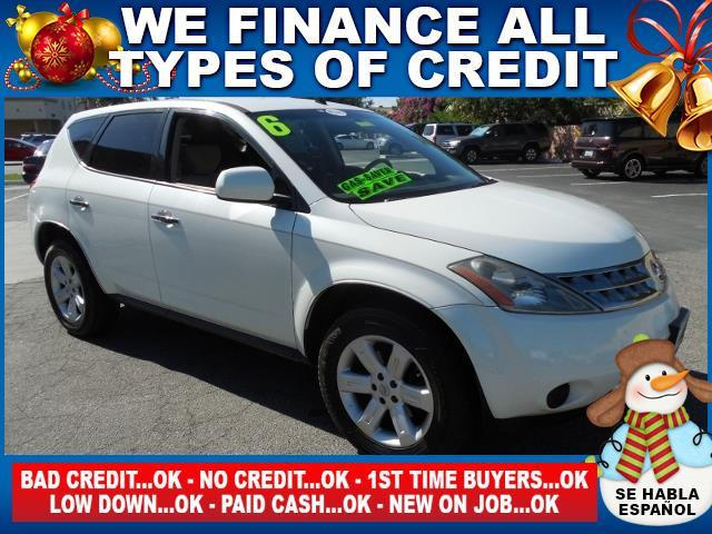 2006 NISSAN MURANO white limited warranty included to assure your worry-free purchase autocheck