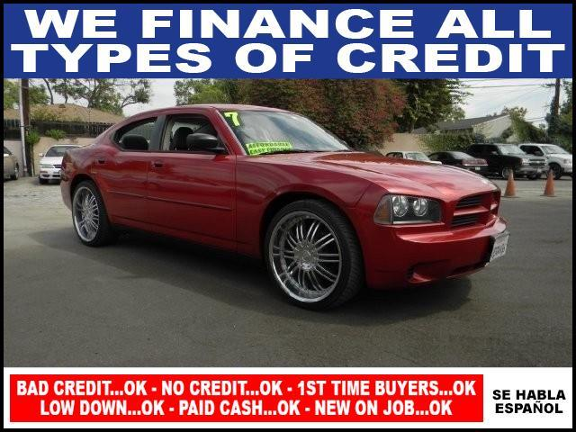 2007 DODGE CHARGER BASE 4DR SEDAN red limited warranty included to assure your worry-free purchas