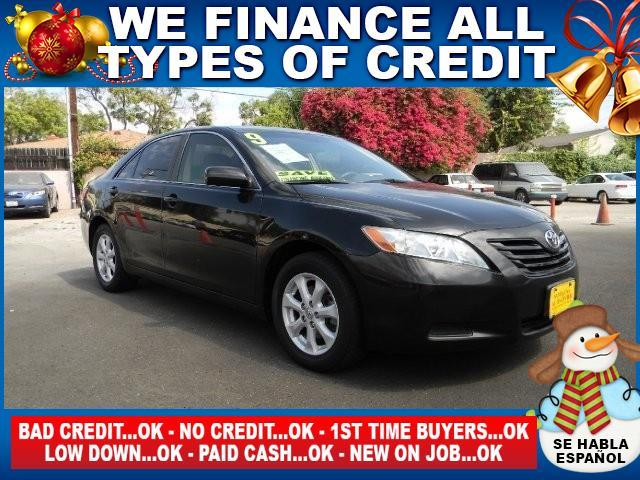 2009 TOYOTA CAMRY LE 4DR SEDAN 5A black limited warranty included to assure your worry-free purch