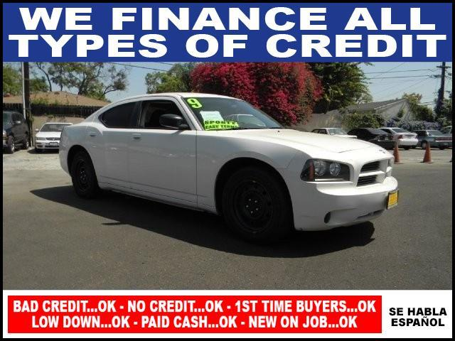 2009 DODGE CHARGER SE 4DR SEDAN white limited warranty included to assure your worry-free purchas