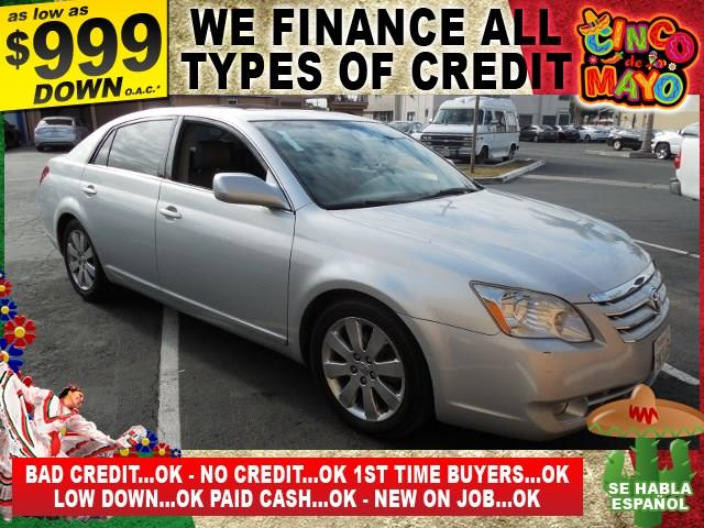 2005 TOYOTA AVALON XLS 4DR SEDAN silver limited warranty included to assure your worry-free purch