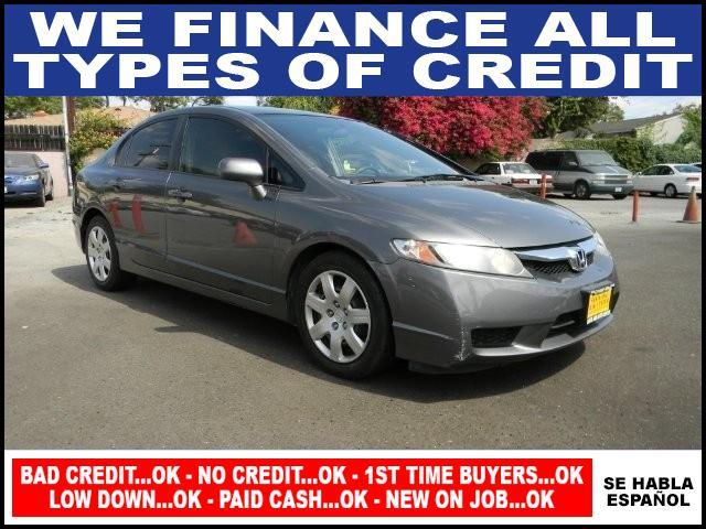 2009 HONDA CIVIC LX 4DR SEDAN 5A gray limited warranty included to assure your worry-free purchas