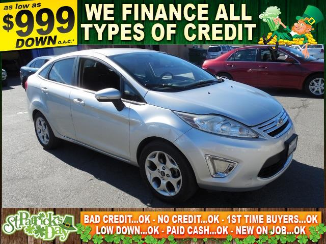2011 FORD FIESTA SEL 4DR SEDAN silver limited warranty included to assure your worry-free purchas