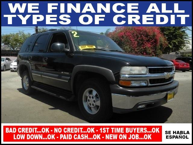 2002 CHEVROLET TAHOE black limited warranty included to assure your worry-free purchase autochec