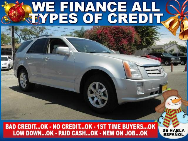 2009 CADILLAC SRX V6 4DR SUV silver limited warranty included to assure your worry-free purchase