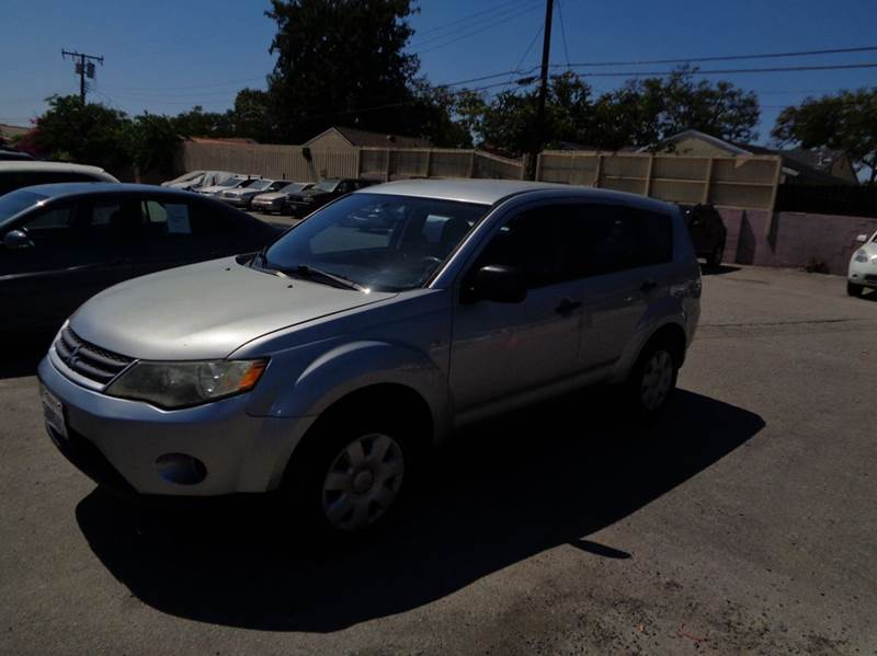 2007 MITSUBISHI OUTLANDER ES 4DR SUV silver limited warranty included to assure your worry-free p