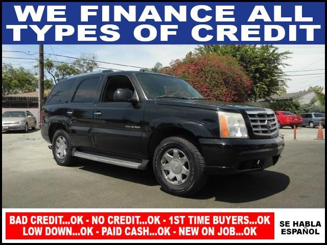 2004 CADILLAC ESCALADE BASE RWD 4DR SUV black limited warranty included to assure your worry-free