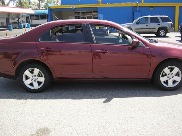 2007 FORD FUSION V6 SE 4DR SEDAN red amfmcd playercd changeranti-theftaccruisepower locks