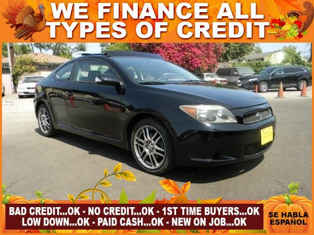 2007 SCION TC BASE 2DR HATCHBACK 24L I4 4A black plimited warranty included to assure your worr