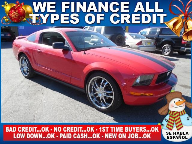 2005 FORD MUSTANG red limited warranty included to assure your worry-free purchase autocheck rep
