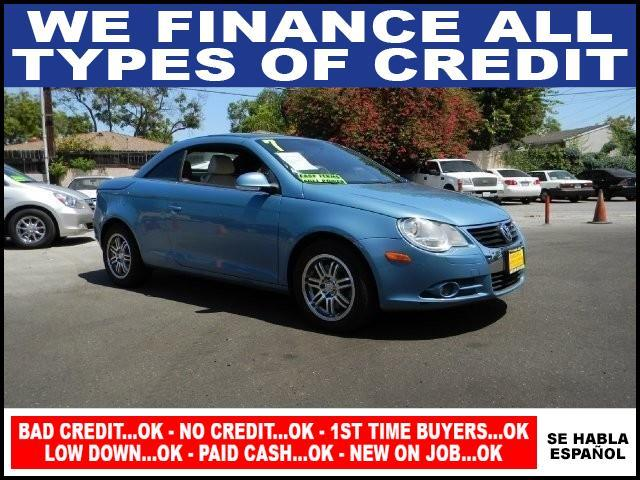 2007 VOLKSWAGEN EOS 20T 2DR CONVERTIBLE 2L I4 6A blue limited warranty included to assure your