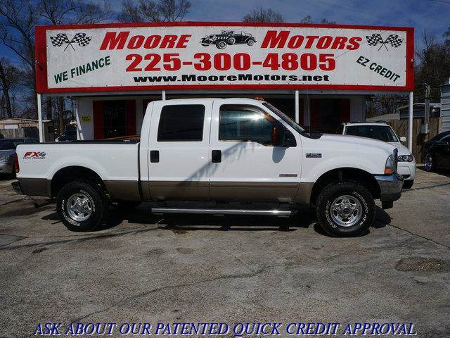 2004 FORD F-250 SUPER DUTY SUPER DUTY LARIAT 4WD white at moore motors everybody rides good cred