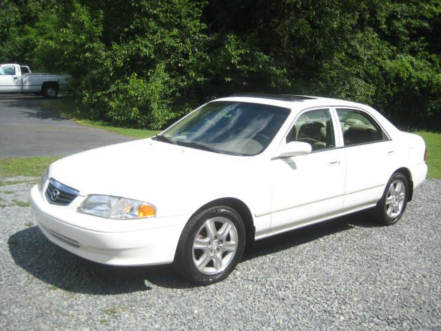 2002 MAZDA 626 ES V6 4DR SEDAN pearl white brand new timing belt and all oil seals also this is