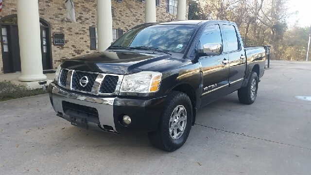 2007 NISSAN TITAN LE FFV 4DR CREW CAB 4WD SB black this is a very well kept nissan tittan le 4x4